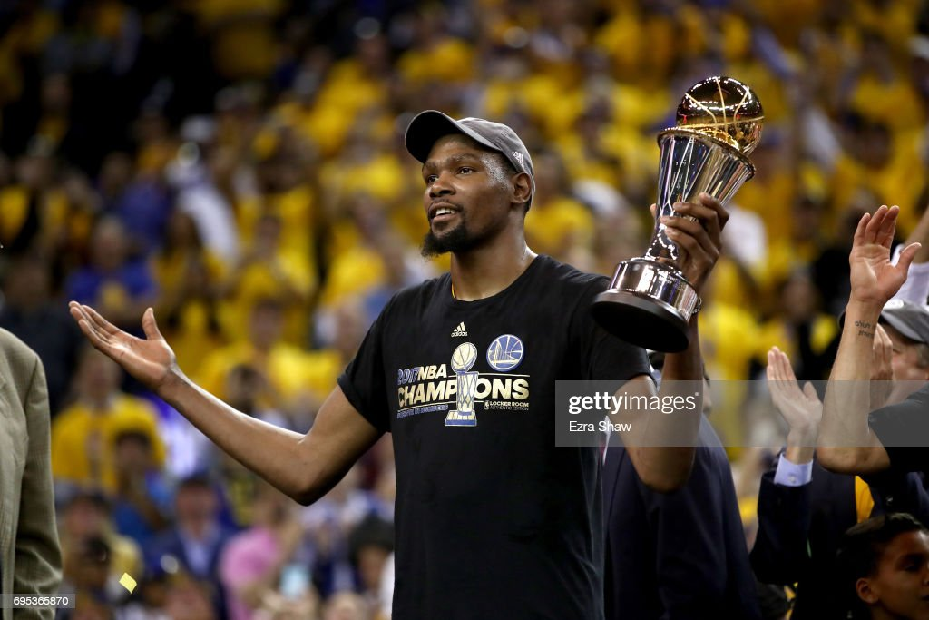 Kevin Durant #35 of the Golden State Warriors celebrates after being named Bill Russell NBA Finals Most Valuable Player after defeating the Cleveland Cavaliers 129-120 in Game 5 to win the 2017 NBA Finals at ORACLE Arena on June 12, 2017 in Oakland, California.