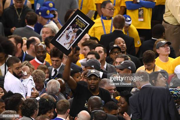 Kevin Durant of the Golden State Warriors celebrates after the Warriors defeated the Cleveland Cavaliers in Game Five of the 2017 NBA Finals on June...