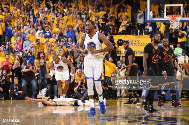 Kevin Durant of the Golden State Warriors celebrates against the Cleveland Cavaliers in Game Five of the 2017 NBA Finals on June 12 2017 at ORACLE...