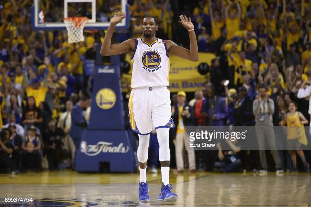Kevin Durant of the Golden State Warriors celebrates in the final moments of their 129120 win in Game 5 over the Cleveland Cavaliers to win the 2017...