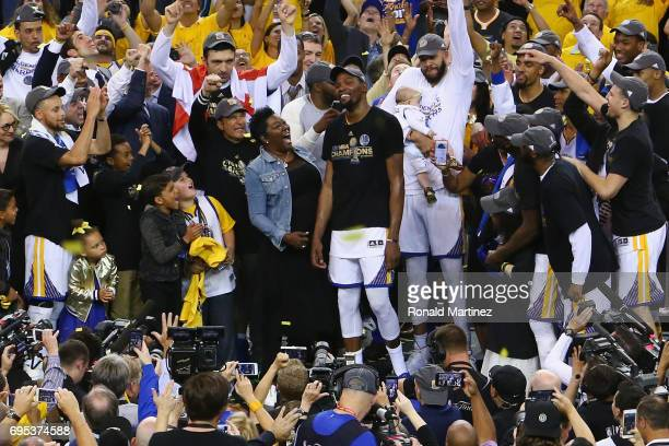 Kevin Durant of the Golden State Warriors celebrates with his mother Wanda after being named Bill Russell NBA Finals Most Valuable Player after...