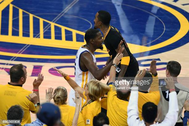 Kevin Durant of the Golden State Warriors celebrates with the fans during the game against the Cleveland Cavaliers in Game Five of the 2017 NBA...