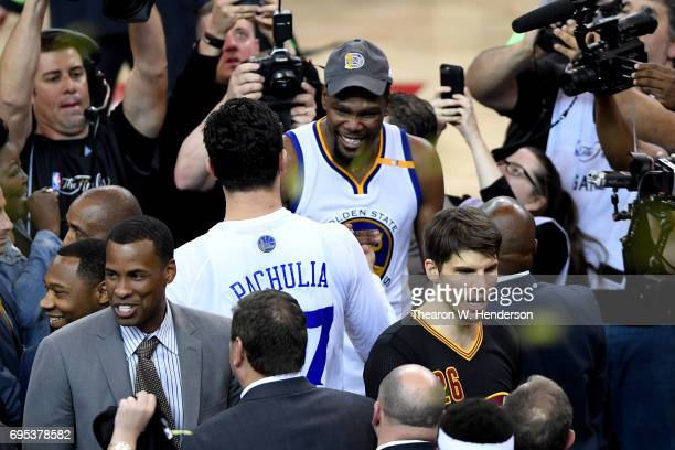 Kevin Durant of the Golden State Warriors celebrates with Zaza Pachulia after defeating the Cleveland Cavaliers 129120 in Game 5 to win the 2017 NBA...