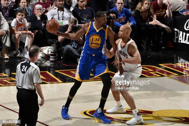 Kevin Durant of the Golden State Warriors controls the ball against Richard Jefferson of the Cleveland Cavaliers in Game Four of the 2017 NBA Finals...