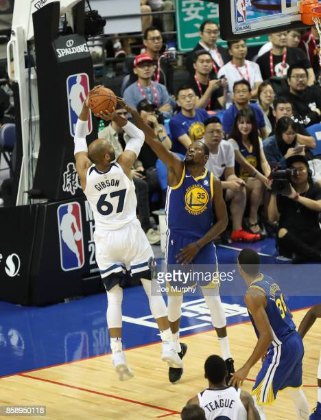 Kevin Durant of the Golden State Warriors defends against Taj Gibson of the Minnesota Timberwolves as part of the 2017 Global Games China on October...