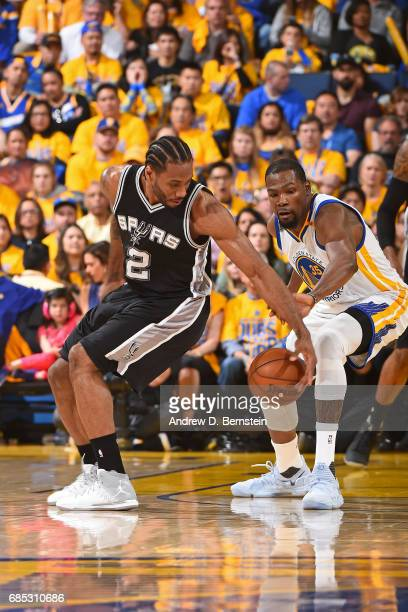 Kevin Durant of the Golden State Warriors defends Kawhi Leonard of the San Antonio Spurs in Game One of the Western Conference Finals during the 2017...