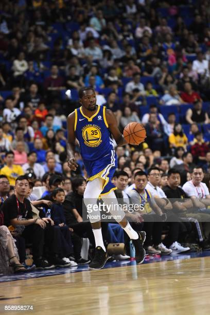 Kevin Durant of the Golden State Warriors dribbles the ball against the Minnesota Timberwolves as part of 2017 NBA Global Games China on October 8...