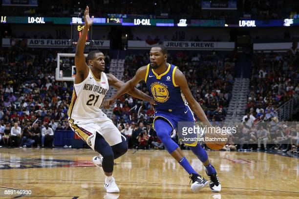 Kevin Durant of the Golden State Warriors drives against Darius Miller of the New Orleans Pelicans during the second half of a game at the Smoothie...