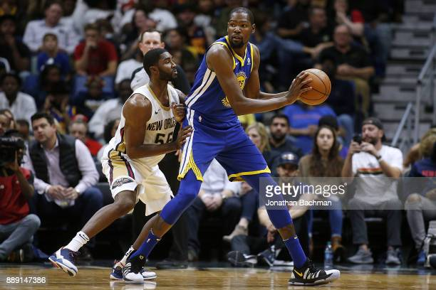 Kevin Durant of the Golden State Warriors drives against E'Twaun Moore of the New Orleans Pelicans during the first half of a game at the Smoothie...