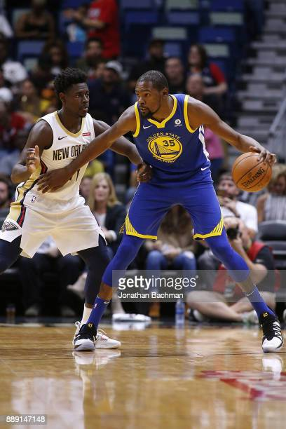 Kevin Durant of the Golden State Warriors drives against Jrue Holiday of the New Orleans Pelicans during the first half of a game at the Smoothie...
