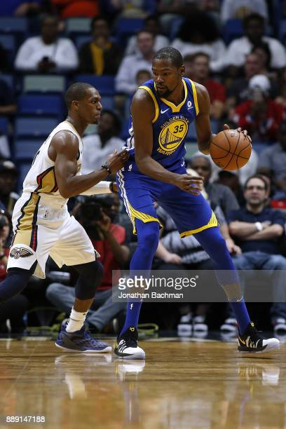 Kevin Durant of the Golden State Warriors drives against Rajon Rondo of the New Orleans Pelicans during the first half of a game at the Smoothie King...