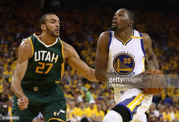 Kevin Durant of the Golden State Warriors drives against Rudy Gobert of the Utah Jazz during Game One of the NBA Western Conference SemiFinals at...
