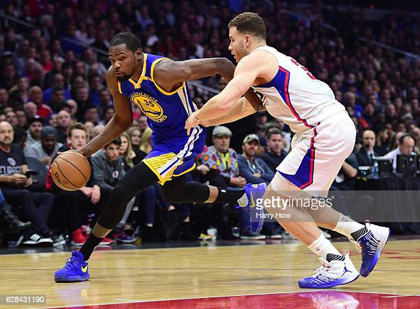 Kevin Durant of the Golden State Warriors drives on Blake Griffin of the LA Clippers during the first half at Staples Center on December 7 2016 in...