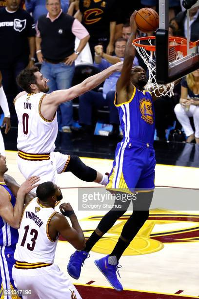Kevin Durant of the Golden State Warriors drives to the basket and is fouled by Kevin Love of the Cleveland Cavaliers in the third quarter in Game 4...