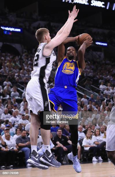 Kevin Durant of the Golden State Warriors drives to the basket against Davis Bertans of the San Antonio Spurs in the first half during Game Three of...