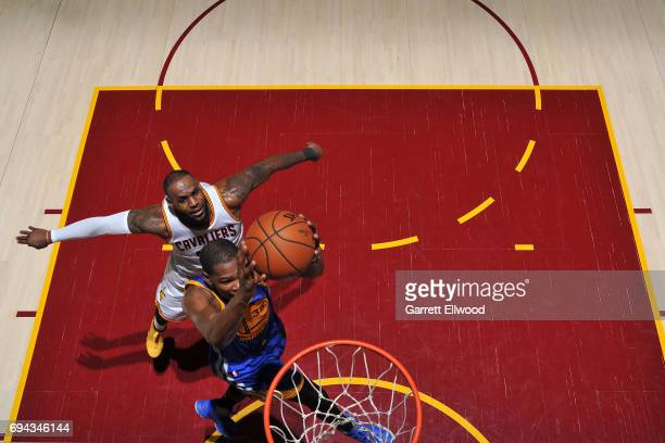 Kevin Durant of the Golden State Warriors drives to the basket against LeBron James of the Cleveland Cavaliers in Game Four of the 2017 NBA Finals on...