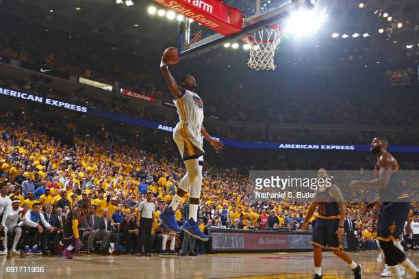 Kevin Durant of the Golden State Warriors drives to the basket to dunk the ball while guarded by LeBron James of the Cleveland Cavaliers in Game One...