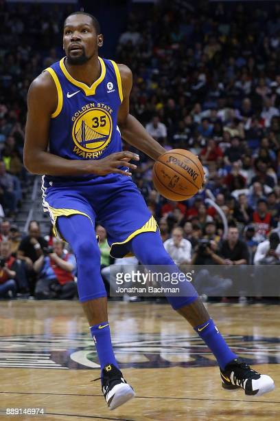 Kevin Durant of the Golden State Warriors drives with the ball during the second half of a game against the New Orleans Pelicans at the Smoothie King...