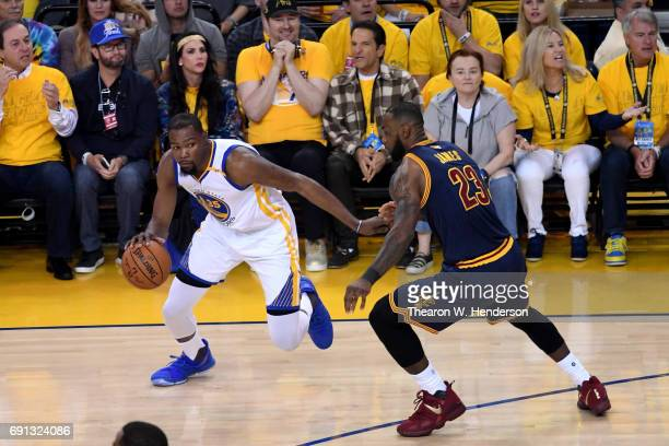 Kevin Durant of the Golden State Warriors drives with the ball against LeBron James of the Cleveland Cavaliers in Game 1 of the 2017 NBA Finals at...