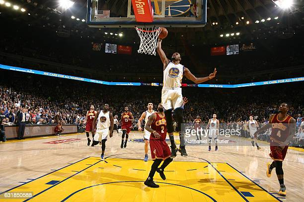 Kevin Durant of the Golden State Warriors dunks against the Cleveland Cavaliers on January 16 2017 at ORACLE Arena in Oakland California NOTE TO USER...