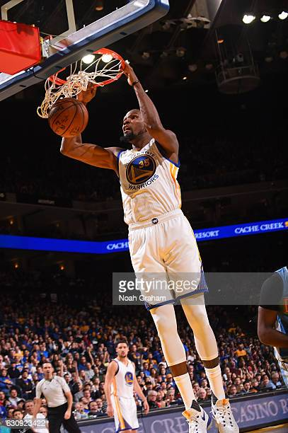 Kevin Durant of the Golden State Warriors dunks against the Denver Nuggets on January 2 2017 at ORACLE Arena in Oakland California NOTE TO USER User...