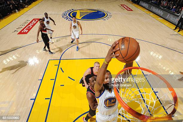 Kevin Durant of the Golden State Warriors dunks against the Portland Trail Blazers during the game on January 4 2017 at ORACLE Arena in Oakland...
