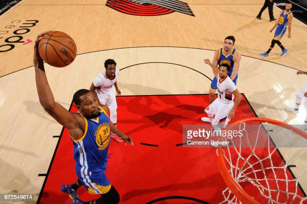 Draymond Green of the Golden State Warriors dunks against the Portland Trail Blazers in Game Four of the Western Conference Quarterfinals of the 2017...