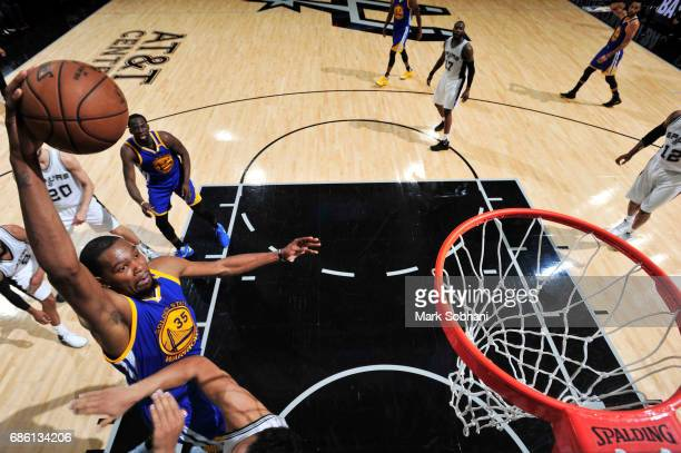 Kevin Durant of the Golden State Warriors dunks against the San Antonio Spurs in Game Three of the Western Conference Finals of the 2017 NBA Playoffs...