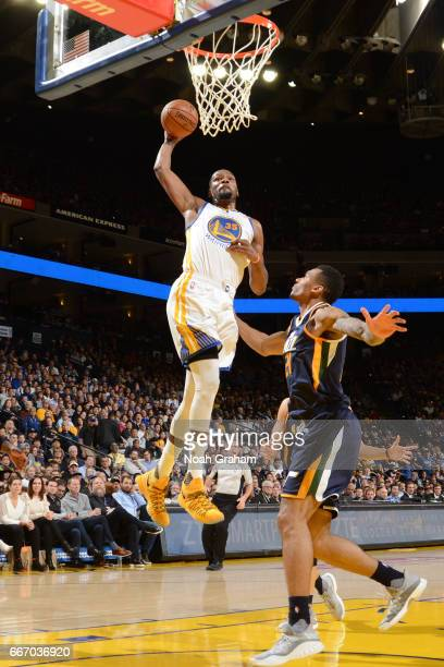 Kevin Durant of the Golden State Warriors dunks against the Utah Jazz on April 10 2017 at ORACLE Arena in Oakland California NOTE TO USER User...