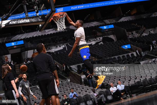 Kevin Durant of the Golden State Warriors dunks before the game against the San Antonio Spurs on March 29 2017 at ATT Center in San Antonio Texas...
