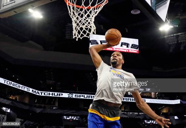 Kevin Durant of the Golden State Warriors dunks before the start of his team's game against the San Antonio Spurs at ATT Center on March 29 2017 in...