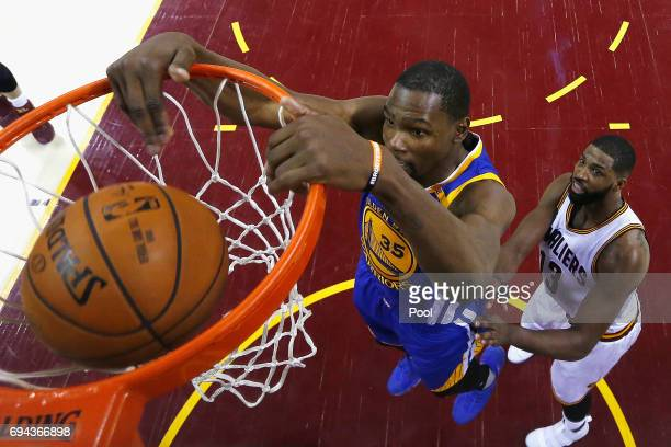 Kevin Durant of the Golden State Warriors dunks in the second half against Tristan Thompson of the Cleveland Cavaliers in Game 4 of the 2017 NBA...