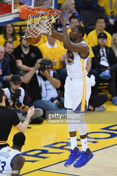 Kevin Durant of the Golden State Warriors dunks the ball against the Cleveland Cavaliers in Game 5 of the 2017 NBA Finals at ORACLE Arena on June 12...