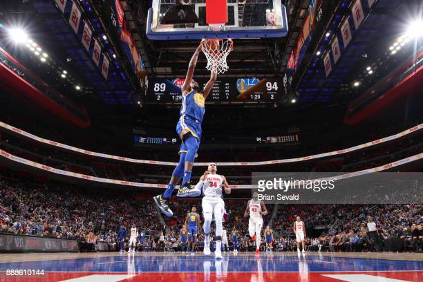 Kevin Durant of the Golden State Warriors dunks the ball against the Detroit Pistons on December 8 2017 at Little Caesars Arena in Detroit Michigan...