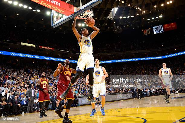 Kevin Durant of the Golden State Warriors dunks the ball during the game against the Cleveland Cavaliers on January 16 2017 at ORACLE Arena in...