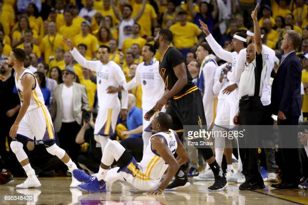 Kevin Durant of the Golden State Warriors falls to the floor after making a threepoint basket in Game 5 of the 2017 NBA Finals at ORACLE Arena on...