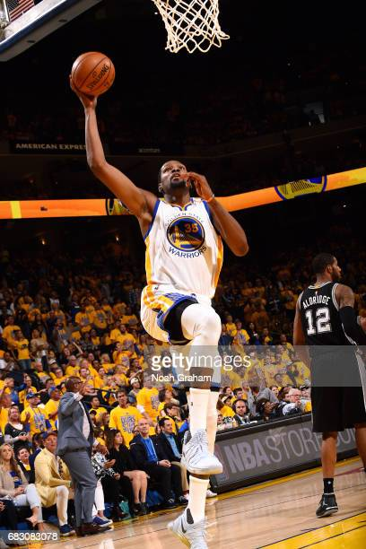 Kevin Durant of the Golden State Warriors goes for a dunk during the game against the San Antonio Spurs during Game One of the Western Conference...