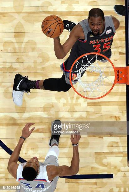 Kevin Durant of the Golden State Warriors goes for a slam dunk against Giannis Antetokounmpo of the Milwaukee Bucks during 2017 NBA AllStar Game at...