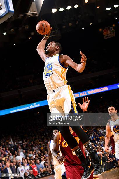 Kevin Durant of the Golden State Warriors goes for the dunk during the game against the Cleveland Cavaliers on January 16 2017 at ORACLE Arena in...