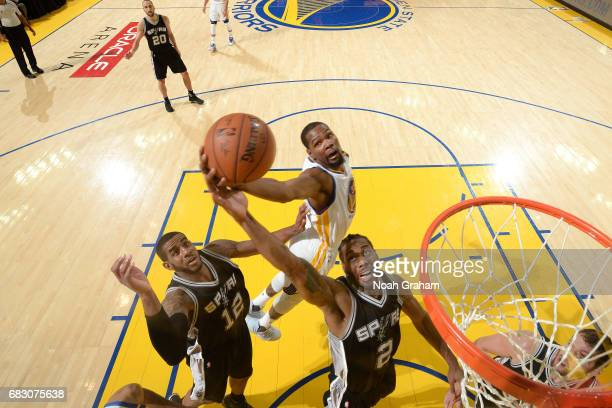 Kevin Durant of the Golden State Warriors goes for the rebound against Kawhi Leonard of the San Antonio Spurs during Game One of the Western...