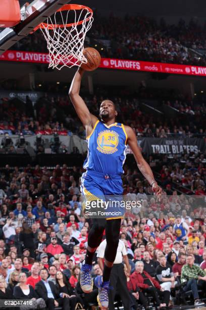 Kevin Durant of the Golden State Warriors goes to the basket against the Portland Trail Blazers during Game Four of the Western Conference...