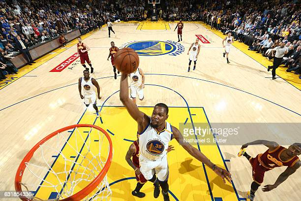 Kevin Durant of the Golden State Warriors goes up for a dunk against the Cleveland Cavaliers on January 16 2017 at ORACLE Arena in Oakland California...