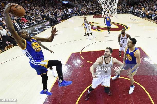 Kevin Durant of the Golden State Warriors goes up for a dunk in the second half against Kevin Love of the Cleveland Cavaliers in Game 3 of the 2017...