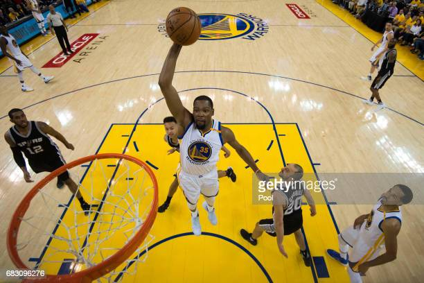 Kevin Durant of the Golden State Warriors goes up for a shot against the San Antonio Spurs during Game One of the NBA Western Conference Finals at...