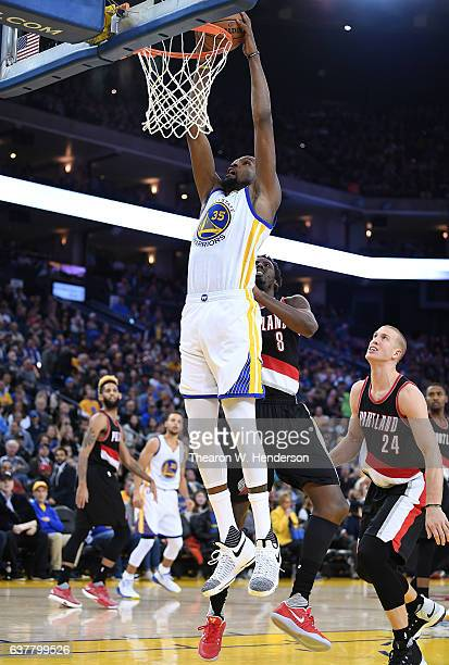 Kevin Durant of the Golden State Warriors goes up for a slam dunk against the Portland Trail Blazers during an NBA basketball game at ORACLE Arena on...
