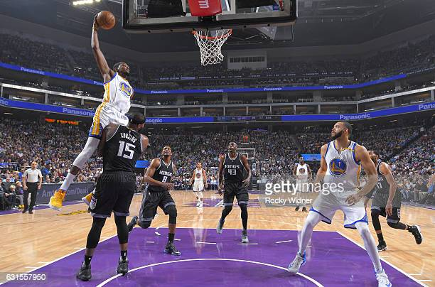 Kevin Durant of the Golden State Warriors goes up for the dunk against DeMarcus Cousins of the Sacramento Kings on January 8 2017 at Golden 1 Center...