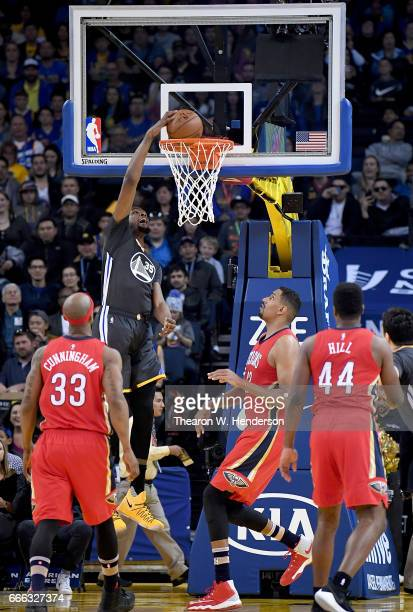 Kevin Durant of the Golden State Warriors goes up to slam dunk the ball against the New Orleans Pelicans in the first quarter of their NBA Basketball...