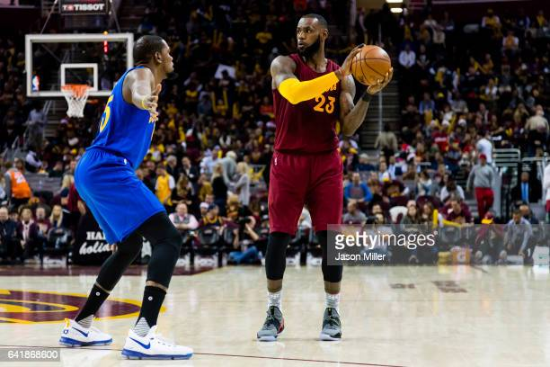 Kevin Durant of the Golden State Warriors guards LeBron James of the Cleveland Cavaliers during the second half at Quicken Loans Arena on December 25...