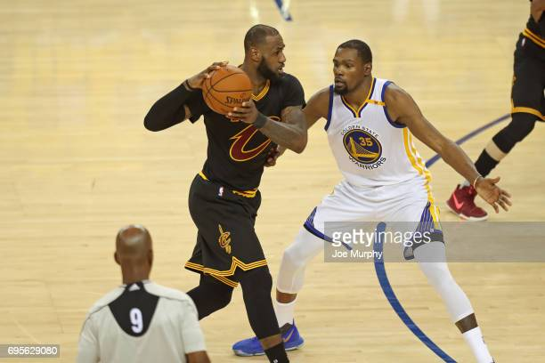 Kevin Durant of the Golden State Warriors guards LeBron James of the Cleveland Cavaliers in Game Five of the 2017 NBA Finals on June 12 2017 at...