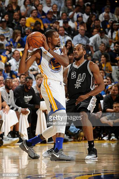 Kevin Durant of the Golden State Warriors handles the ball against Kawhi Leonard of the San Antonio Spurs on October 25 2016 at ORACLE Arena in...
